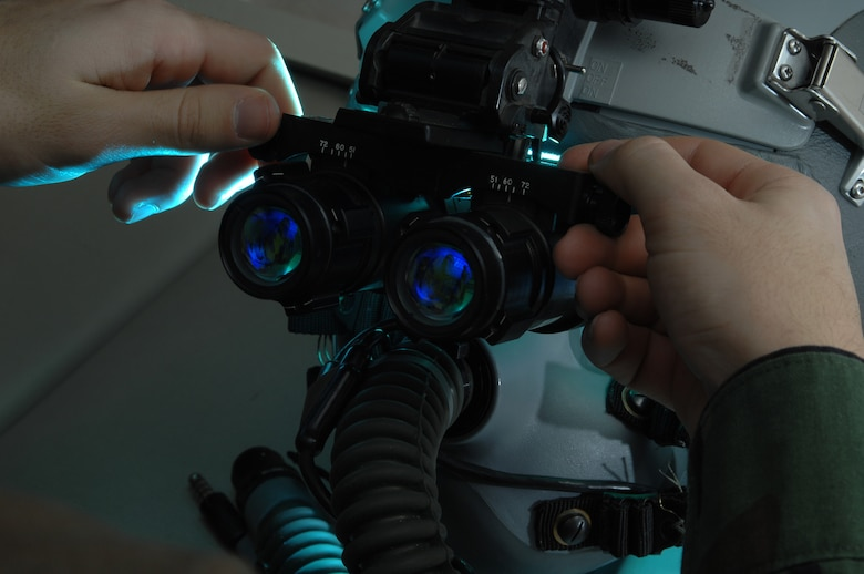EIELSON AIR FORCE BASE, Alaska -- Airman First Class Andrew Witherspoon adjust the eyespan on a pair of AN/AVS-9 Night Vision Goggles (NVG's) in the Life Support Section of the 355th Fighter Squadron here on 29 Nov. During the winter months pilots of Eielson Air Force Base, Alaska are given a greater opportunity to train with NVG's more than their counterparts in the lower 48 states due to the decrease length of sunlight. (U.S. Air Force Photo by Staff Sgt Joshua Strang)