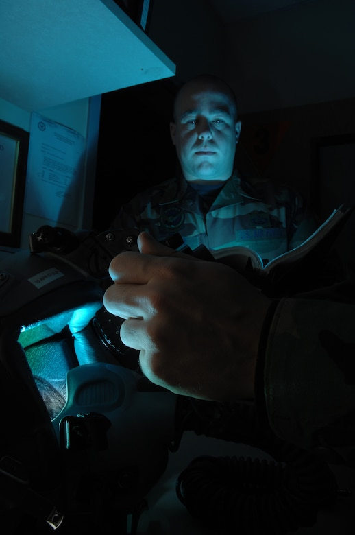 EIELSON AIR FORCE BASE, Alaska -- Staff Sgt Timothy Huffman consults the Technical Order while Airman First Class Andrew Witherspoon adjust the eyespan on a pair of AN/AVS-9 Night Vision Goggles (NVG's) in the Life Support Section of the 355th Fighter Squadron here on 29 Nov. During the winter months pilots of Eielson Air Force Base, Alaska are given a greater opportunity to train with NVG's more than their counterparts in the lower 48 states due to the decrease length of sunlight. (U.S. Air Force Photo by Staff Sgt Joshua Strang)