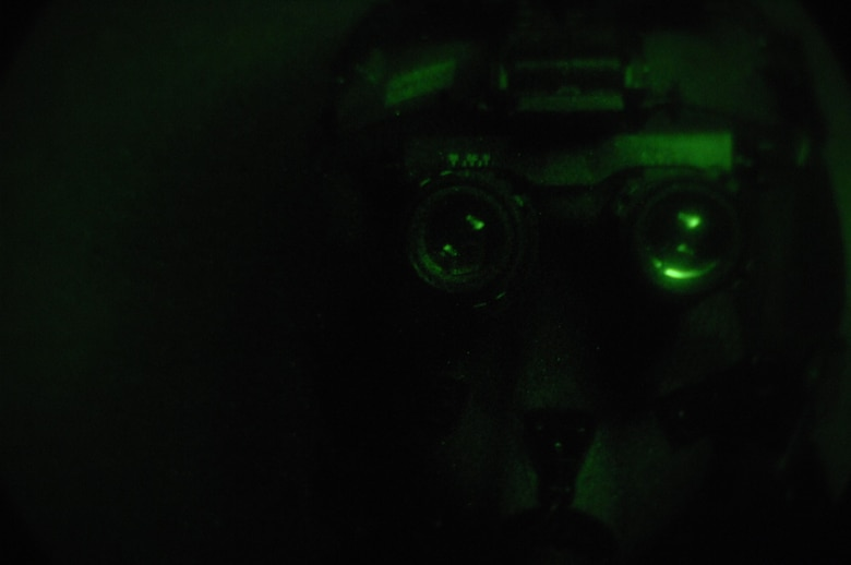 EIELSON AIR FORCE BASE, Alaska -- Staff Sgt Timothy Huffman checks for lens defects on a pair of AN/AVS-9 Night Vision Goggles (NVG's) in the Life Support Section of the 355th Fighter Squadron here on 29 Nov. During the winter months pilots of Eielson Air Force Base, Alaska are given a greater opportunity to train with NVG's more than their counterparts in the lower 48 states due to the decrease length of sunlight. (U.S. Air Force Photo by Staff Sgt Joshua Strang)