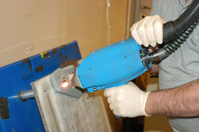 Handheld laser devices that can remove paint from small-area aircraft