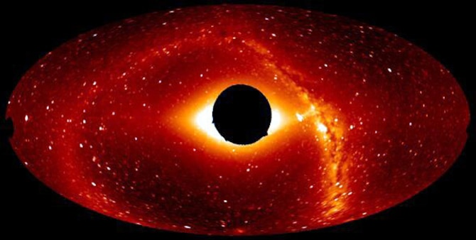 An all-sky composite image taken by the experimental Solar Mass Ejection Imager displays the dark, 20º exclusion zone around the sun, stars, and Milky Way galaxy.  The SMEI's three cameras produce a view of objects in space at a range beginning 20º outwards from the sun and extending beyond the earth (US Air Force photo).