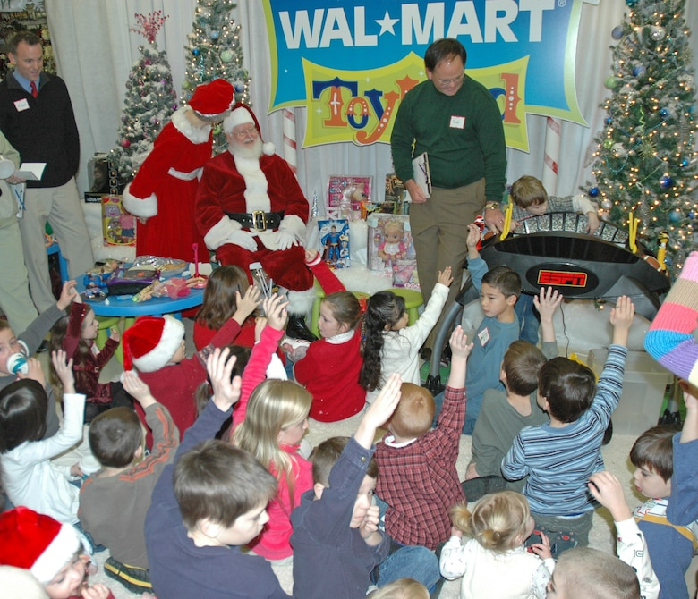 "EIELSON AIR FORCE BASE -- Children from the Top of the World Toy Summit raise there hands in an oath to Santa that they will be ""nice"" this year. More than 30 military children served as toy testers and ""ambassadors of fun"" during the morning festivities. (U.S. Air Force photo by Senior Airman Justin Weaver)."