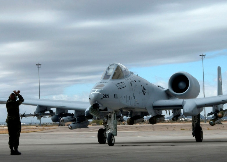 A newly modified A-10C Thunderbolt II taxis in during the roll-out ceremony Nov. 29 at Davis-Monthan Air Force Base, Ariz.  The A-10 has been modified with precision engagement technology to create the new and improved A-10C.  The enhancements include full integration of sensors, multi-functional color displays and a new hands-on-throttle-and-stick interface.  (U.S. Air Force photo/Airman 1st Class Alesia Goosic)