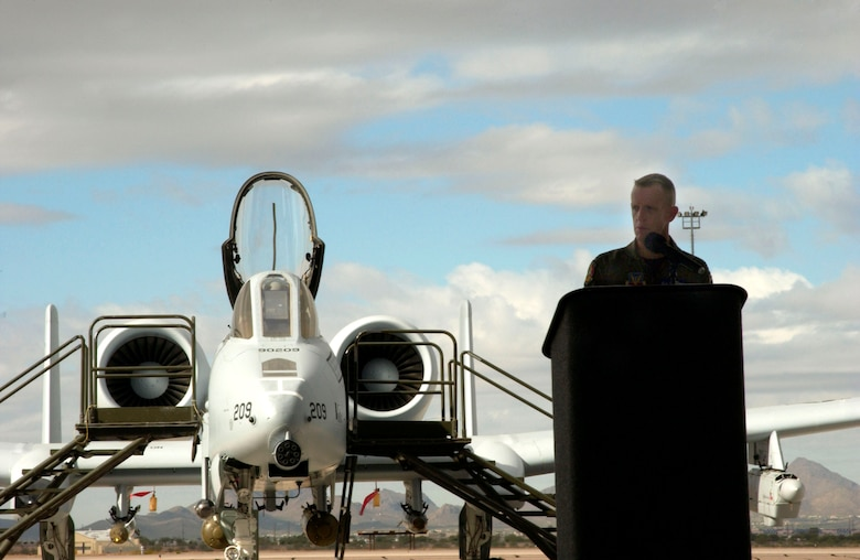 Col. Kent Laughbaum introduces the new A-10C Thunderbolt II during a 355th Wing roll-out ceremony at Davis-Monthan Air Force Base, Ariz. Nov. 29.  The A-10 has been modified with precision engagement technology to create the new and improved A-10C.  The enhancements include full integration of sensors, multi-functional color displays and a new hands-on-throttle-and-stick interface.  Colonel Laughbaum is the 355th Wing commander.  (U.S. Air Force photo/Airman 1st Class Alesia Goosic)