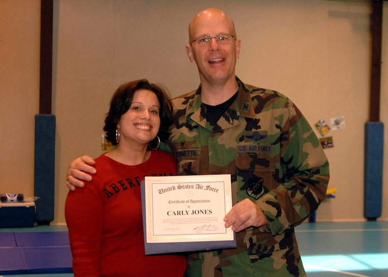 "Col. Murrell ""Tip"" Stinnette, (right) 39th Air Base Wing commander, presents a Certificate of Appreciation to Carly Jones for her outstanding volunteer work at the Youth Center, Nov. 28. (U.S. Air Force photo by Airman Kelly L. LeGuillon)"