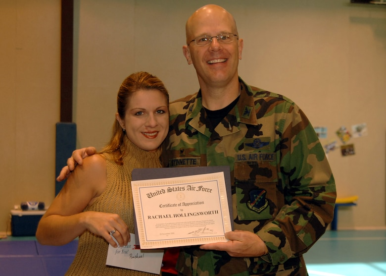 "Col. Murrell ""Tip"" Stinnette, (right) 39th Air Base Wing commander, presents a Certificate of Appreciation to Rachael Hollingsworth for her outstanding volunteer work at the Youth Center, Nov. 28. (U.S. Air Force photo by Airman Kelly L. LeGuillon)"