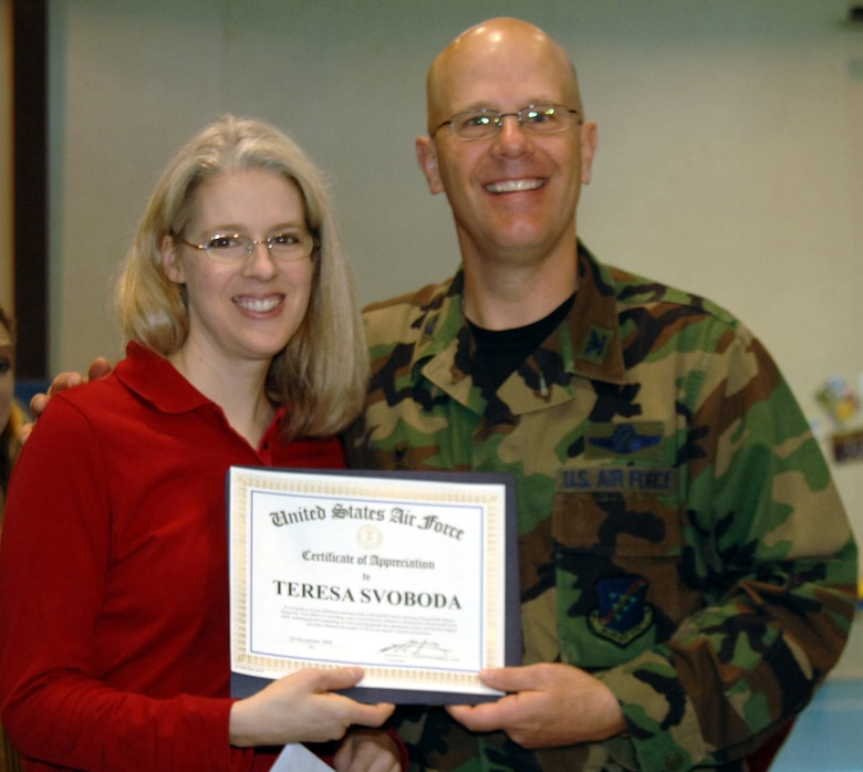 "Col. Murrell ""Tip"" Stinnette, (right) 39th Air Base Wing commander, presents a Certificate of Appreciation to Teresa Svoboda for her outstanding volunteer work at the Youth Center, Nov. 28. (U.S. Air Force photo by Airman Kelly L. LeGuillon)"