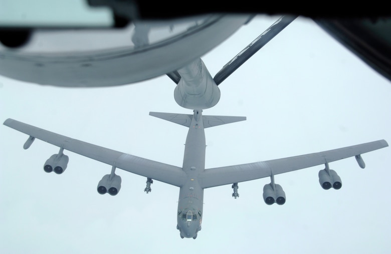 A B-52 from the 23rd Expeditionary Bomb Squadron climbs into position during a recent air refueling mission near Andersen Air Force Base, Guam.   (U.S. Air Force photo by Staff Sgt. Patrick Mitchell)
