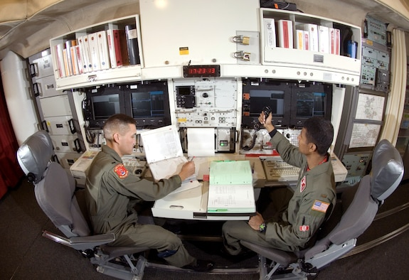 Typically, a two-person missile combat crew is on alert in an underground launch control center for 24 hours at a time monitoring their ICBMs, ready to launch them if directed.  Under a test being conducted by 20th Air Force officials, three-person crews are going to pull 72-hour alerts at select facilities to weigh the advantages of going to such a schedule.  Officials from 20th Air Force will evaluate the test after three months to determine whether to implement the initiative across the entire missile force.   (U.S. Air Force photo/Master Sgt. Lance Cheung)