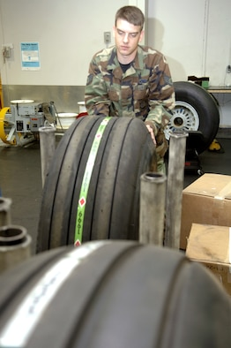 Staff Sgt. Joseph Kokesh checks the tire inventory in the 92nd Maintenance Squadron's wheel and tire shop for KC-135 Stratotankers. An Air Force Smart Operations 21 initiative is under way in the shop to eliminate almost half of the current tire stock. The reduction should result in a significant cost avoidance for the Air Force. (U.S. Air Force photo/Senior Airman Chad Watkins)