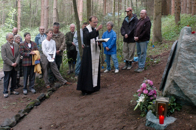 A priest from nearby Vostenhof, Austria, presides over an Aug. 27 memorial service for the members of a B-17 bomber that crashed in the area May 10, 1944. The service was attended by family, friends and members of the Joint POW/MIA Accounting Command. An 18-member JPAC team, including a forensic anthropologist, explosive ordnance disposal technician and field medic, from Hickam Air Force Base, Hawaii, returned Oct. 1 after 45 days in Austria attempting to recover the remains of 1st Lt. Stanley Dwyer and gunner Sgt. John Boros who were lost in the crash. The mission of JPAC is to achieve the fullest possible accounting of all Americans missing as a result of the nation's past conflicts. (U.S. Air Force photo/Staff Sgt. Derrick C. Goode)