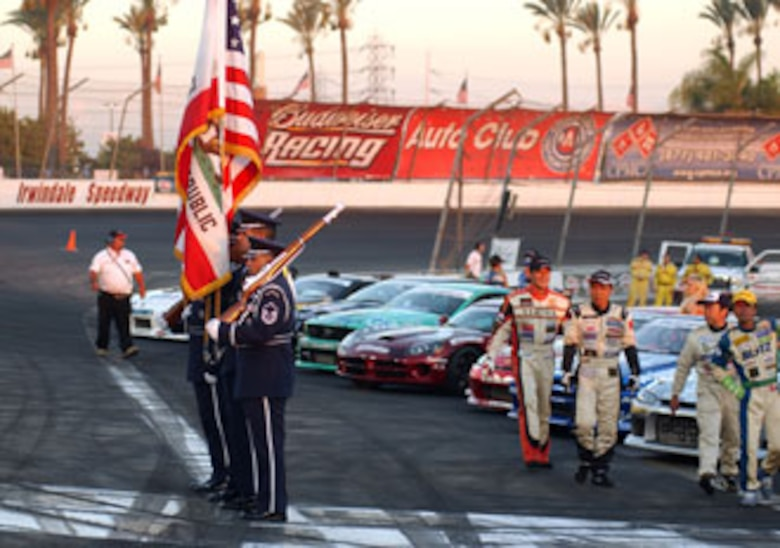 Cutline:  Members from the Blue Eagles Total Force Honor Guard at March Air Reserve Base prepare to present the colors during the opening ceremonies at a recent drifting event at the Irwindale Speedway which was co-sponsored by the Air Force Reserve Command. The event featured some of the best professional drifters in D1 taking on some of NASCAR's brightest stars, including Kasey Kahne, Matt Kenseth, Bill Elliott, Greg Biffle, Robby Gordon and Casey Mears, in a drifting exhibition. (U.S. Air Force photo by Mr. Erickson Barnes, 452 AMW/PA)