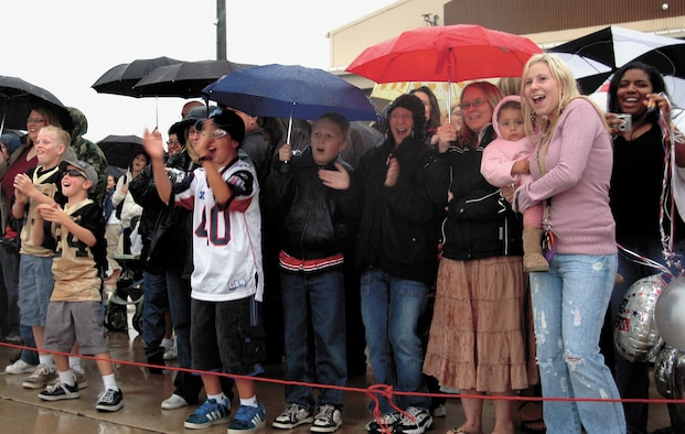 Family and friends cheer as the commercial airline carrying 421st EFS Airmen pulls up to Hangar 37 Friday at about 4 p.m.