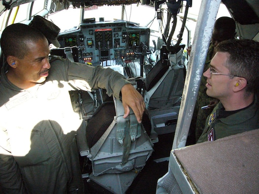 Botswana Defence Force Capt. Tino Phuthego, C-130 pilot, and U.S. Air Force Maj. Jim Wandmacher, 86th Operations Support Squadron C-130 navigator, discuss preflight procedures Sept. 24 at the Kigali International Airport in Rwanda. Photo by Capt. Erin Dorrance