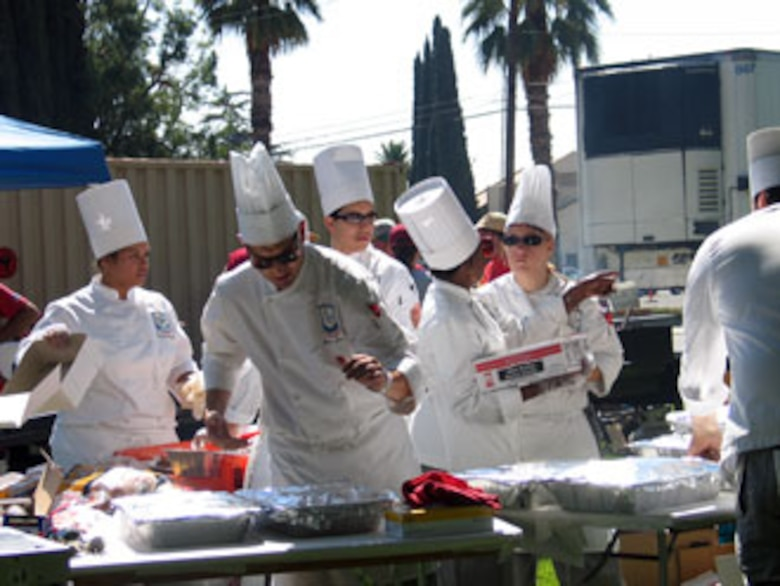 Cooks from the Riverside Culinary School prepare the food during the annual base wide picnic held on Saturday, September 16. The local communities of Riverside and Moreno Valley organized and funded the picnic to show their appreciation to the military members who work at the base. More than 5,000 military members and their families attended the event. This is the 34th appreciate day picnic the community has hosted for March Air Reserve Base. (U.S. Air Force photo by MSgt Carson Hampton)