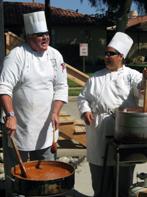 Two cooks from the Riverside Culinary School prepare the food during the annual base wide picnic held on Saturday, September 16. The local communities of Riverside and Moreno Valley organized and funded the picnic to show their appreciation to the military members who work at the base. More than 5,000 military members and their families attended the event. This is the 34th appreciate day picnic the community has hosted for March Air Reserve Base. (U.S. Air Force photo by MSgt Carson Hampton)