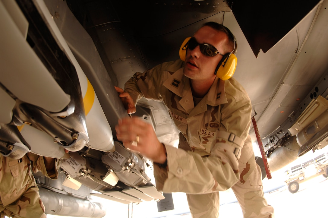 Capt. Jim Parslow, Small Diameter Bomb Systems Flight commander, inspects a weapons carriage with GBU-39/B small diameter bombs mounted on an F-15E Strike Eagle. Captain Parslow is deployed to a forward-operating location from the Air Armament Center at Eglin Air Force Base, Fla., to support the fielding of the SDB and to ensure a smooth transition from the weapon testing to combat operations. (U.S. Air Force photo/Senior Airman Ricky Best)