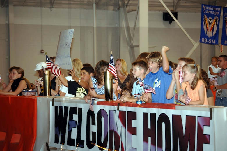 Family members cheer the arrival of their returning loved ones Monday night in Commando Hanger during the first Operation Homecoming.  More than 200 Hurlburt Field and Eglin Air Force Base Airmen returned home from Southwest Asia. (U.S. Air Force Photograph by Senior Airman Andy Kin)