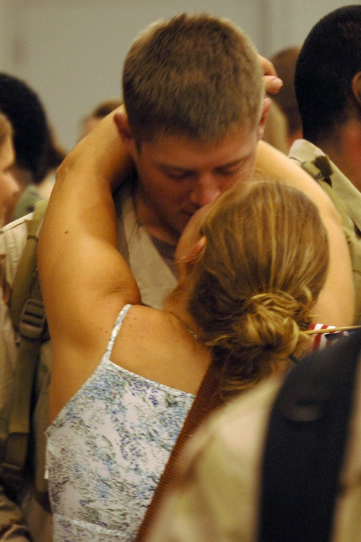 Senior Airman Matt Owen, 16th Communications Squadron, is welcome home by his wife, Senior Airman Ali Flisek, 16th CS, after he returned home Monday night from deployment,  This was the first Operation Homecoming held at Hurlburt Field. (U.S. Air Force Photograph Senior Airman Andy Kin)