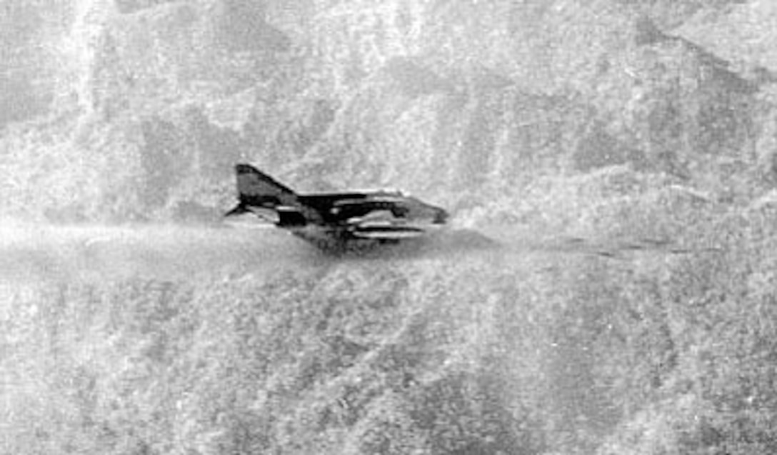 McDonnell Douglas F-4C in flight firing a salvo of 2.75 FFA rockets in the mountains of North Vietnam in April 1966. (U.S. Air Force photo)