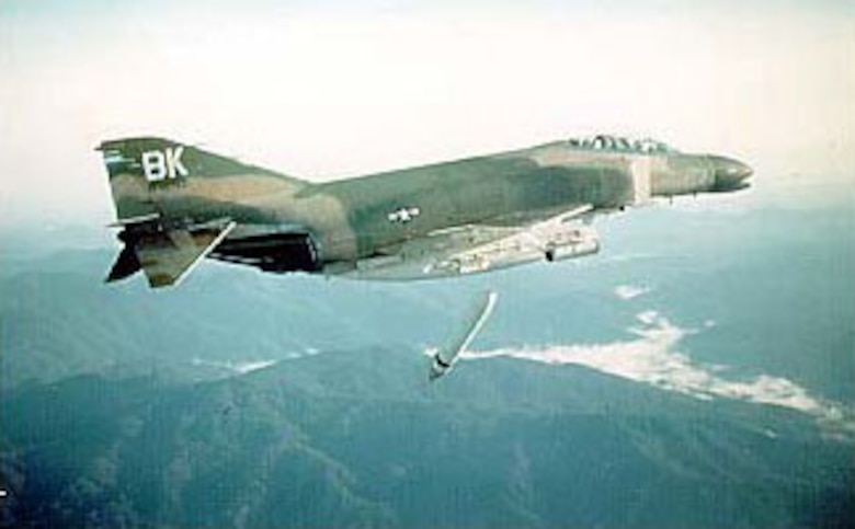 McDonnell Douglas F-4C-23-MC (S/N 64-762) in flight dropping Cluster Bomb Unit dispenser over the A Shau Valley, South Vietnam, on June 23, 1967. (U.S. Air Force photo)