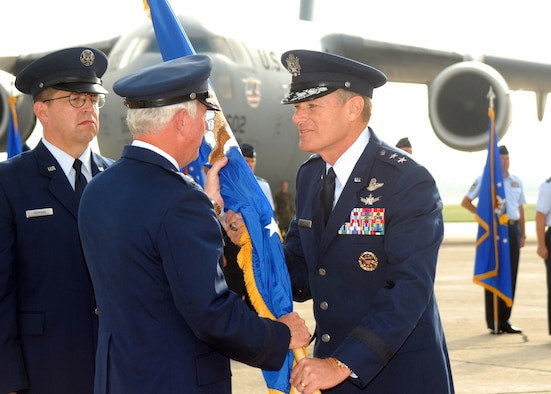 Maj. Gen. Irving Halter Jr. (right) accepts the flag representing command of the 19th Air Force from Gen. William R. Looney III, Air Education and Training Command commander, during a change of command ceremony Oct. 3 on the ramp in front of Randolph AFB Base Operations. (U.S. Air Force photo by Rich McFadden)