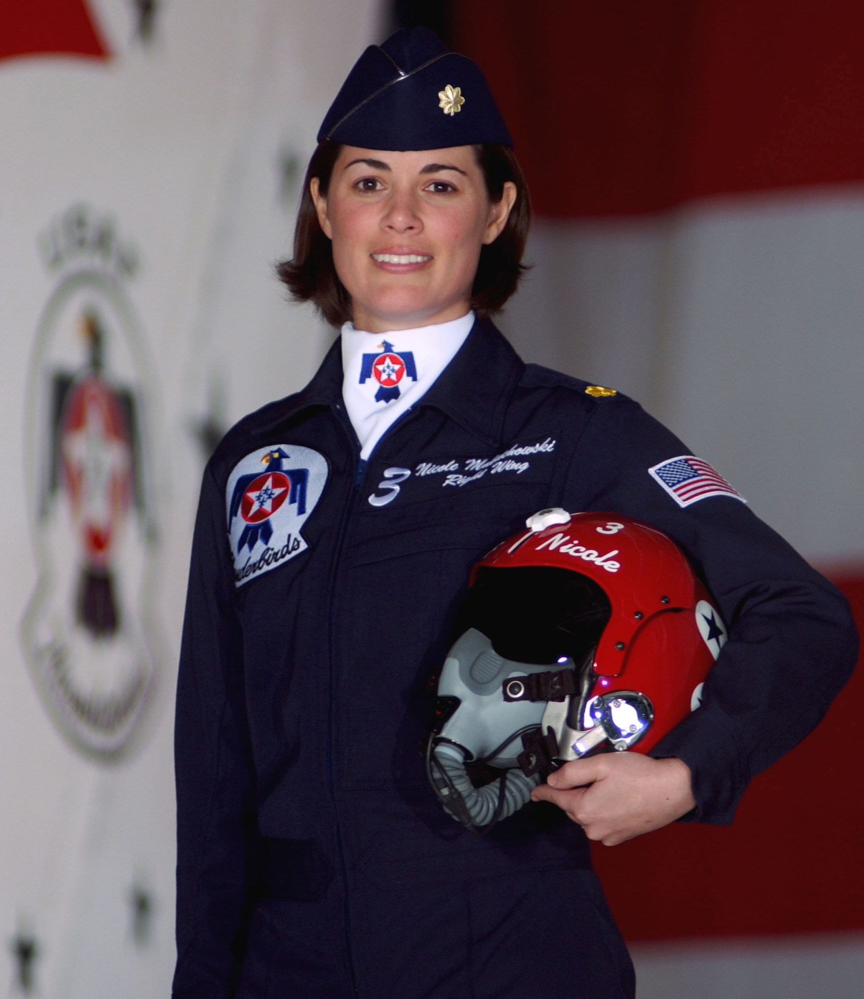 Maj. Nicole Malachowski is the first woman pilot on the U.S. Air Force Thunderbirds. The Thunderbirds are in Washington for the dedication of the Air Force Memorial, scheduled for Oct. 14.   (U.S. Air Force photo)