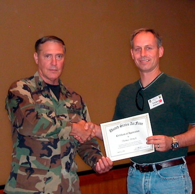 Col. William Rollin, 349th Mission Support Group, presents a certificate of appreciation to Mr. Thomas Puruch, during a recent Employer Appreciation Day event. (U.S. Air Force file photo)