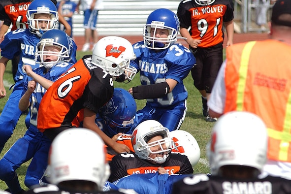 Riley Arnold, No. 33, tackles an opponent during a Junior Pee Wee football game at the Wheatland High School football field. Riley is a fourth grader from Lone Tree Elementary School and is the only girl on the Pirates Junior Pee Wee football team. (Courtesy photo)