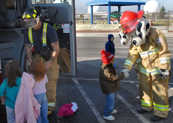 BUCKLEY AIR FORCE BASE, Colo. -- The base fire fighters and their mascot, Sparky the Fire Dog, visited the Child Development Center here Oct. 12 to teach the children about fire saftey and show them their equipment. Visiting the CDC was one of the events planed for Fire Prevention Week on the base. (U.S. Air Force photo by Senior Airman Steve Czyz)