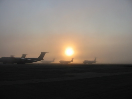 New England fog shrouds a flightline at Westover ARB, Mass., as Air Force Reserve Command C-5 Galaxy transports await their missions. Westover is the home the 439th Airlift Wing, which includes more than 2,500 reservists from 32 states. (US Air Force photo / Master Sgt. Steven Ross )