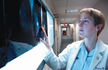 Maj. (Dr.) Shannon Lehr screens a set of mammogram X-rays in conjunction with a patient's office visit. Major Lehr is one of four general surgeons assigned to the 79th Surgical Operations Squadron at Malcolm Grow Medical Center. The American Cancer Society, a nationwide health organization, encourages women ages 20 and older to conduct breast self-examinations monthly. Breast examinations and screenings by a doctor are also recommended annually.