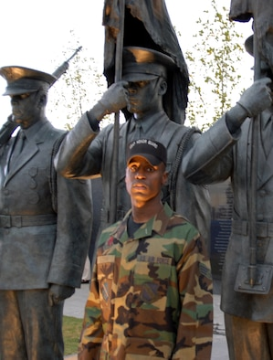 Senior Airman Michael Goodwin stands in front of the Air Force Honor Guard statue he was used as a model for, which now resides at the Air Force Memorial.  (U.S. Air Force photo/Senior Airman David Merrick)