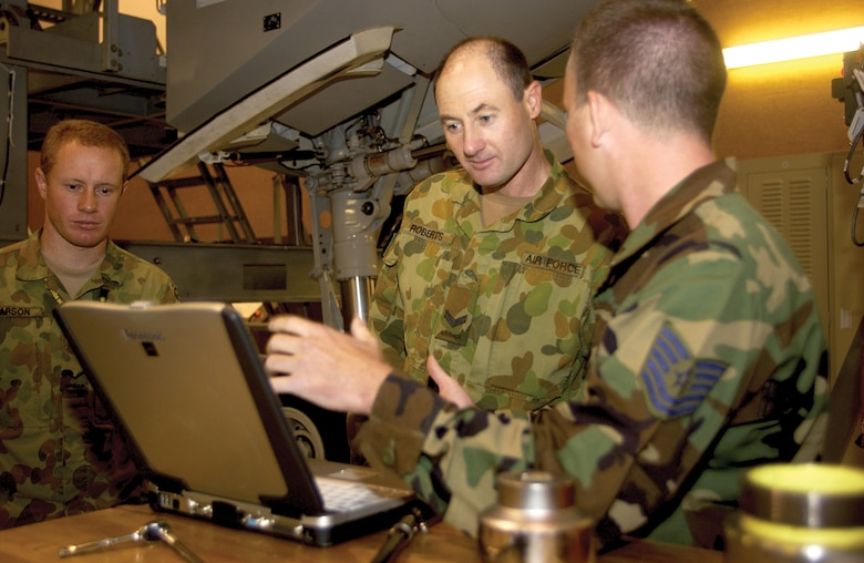 Royal Australian Air Force Cpl. David Roberts (center) and Leading Aircraftsman Michael Clarson (left), go over computer-based technical orders with Tech. Sgt. Troy Barber, 373rd Training Squadron Detachment 5, at the 373 DET. 5 training building Sept. 29. Twenty-four RAAF members have been at Charleston AFB since July 31 receiving training on C-17 maintenance procedures.  (U.S. Air Force photo/Airman 1st Class Sam Hymas)