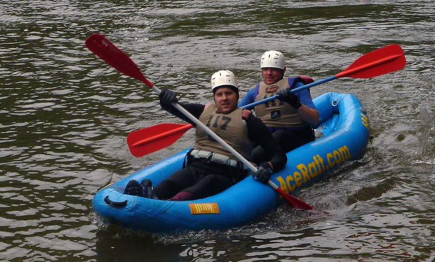 Dick Fulton and Mike Sonderman, members of the Defense Finance Accounting Service and 460th Comptroller Squadron Wilderness Challenge team, DFASt, paddle in after completing the two-person kayak event. The team competed against 50 military teams in six events that totaled 53 miles Oct. 6 and 7 and won first out of five Air Force teams and 16th out of 51 total teams.