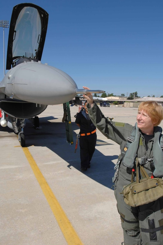 Lt. Col. Sharon Preszler, 20th Fighter Wing staff director and Commander's Action Group director, prepares for her fini flight Thursday at Shaw. Col. Preszler was the first female active-duty fighter pilot. (U.S. Air Force photo/Staff Sgt. Josef Cole III)