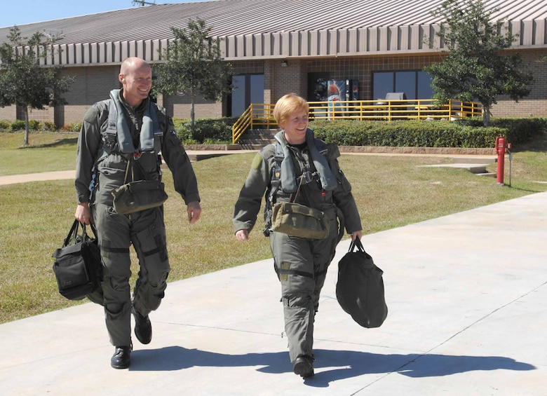 Lt. Col. Sharon Preszler, 20th Fighter Wing staff director and Commander's Action Group director, and Lt. Col. Scott Manning, 79th Fighter Squadron commander, walk out to their jets Thursday for Col. Prezsler's fini flight. (U.S. Air Force photo/Staff Sgt. Josef Cole III)