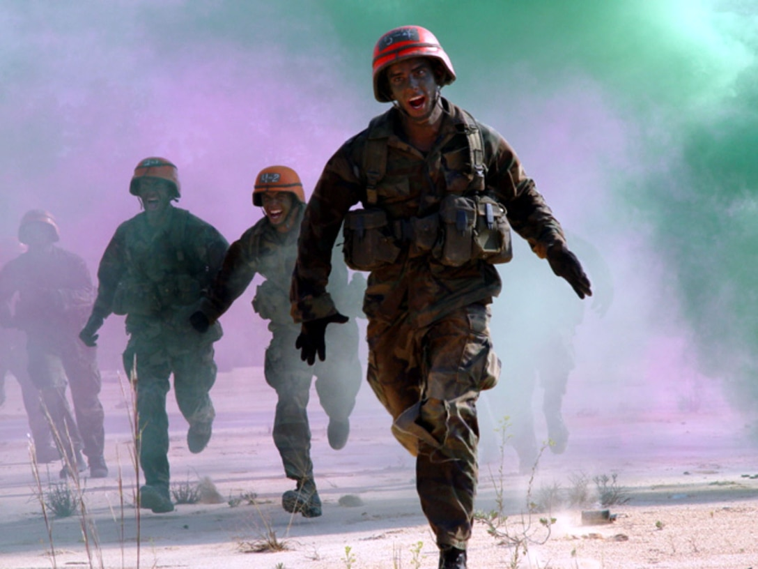 Tactical Air Control Party  students rush through smoke as they move onto small unit tactics training. (U.S. Air Force Photograph by Technical Sgt. Brian Murray)