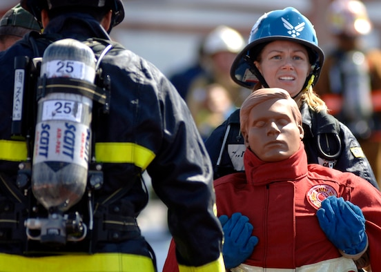 Shenah Groom, Team Travis, carries a 175-pound dummy to the finish line of the tandem portion of the Firefighter Combat Competition at Morrow, Ga., Oct. 13, 2006.  The competition is a national competition with over 450 firefighters from around the U.S.  (U.S. Air Force photo/Tech. Sgt. Cecilio M. Ricardo Jr.)