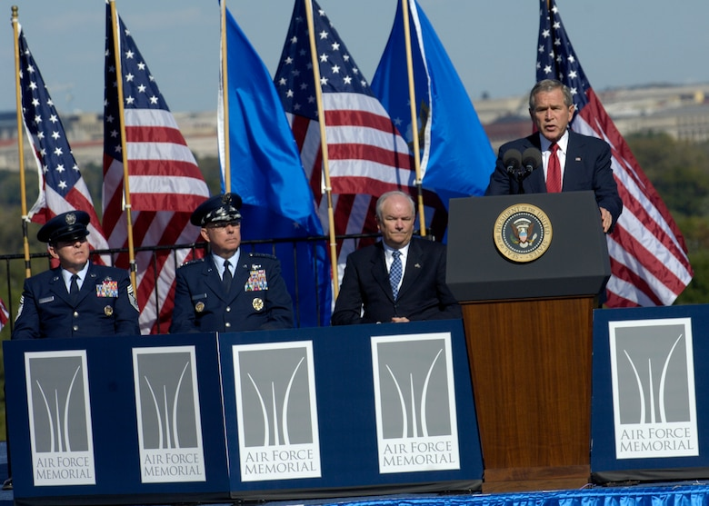On behalf of all American citizens President George W. Bush accepts the Air Force Memorial during a dedication ceremony at its Arlington, Va. location overlooking the Pentagon on Saturday, Oct. 14, 2006. Looking on are, from left: Chief Master Sgt. of the Air Force Rodney J. McKinley, Air Force Chief of Staff Gen. T. Michael Moseley and  Secretary of the Air Force Michael W. Wynne. Designed by the late James Ingo Freed the memorial with its three soaring spires inspired by the U.S. Air Force Thunderbirds bomb burst manuever, pays tribute to and honors the patriotic men and women of the U.S. Air Force and its predeccessor organizations. An open house will run near the Pentagon in conjunction with the dedication ceremony which will feature performances by the U.S. Air Force Band, the U.S. Air Force Honor Guard drill team, and will culminate with a concert featuring country music performer LeeAnn Womack. (U.S. Air Force photo/Tech. Sgt. Cohen Young)