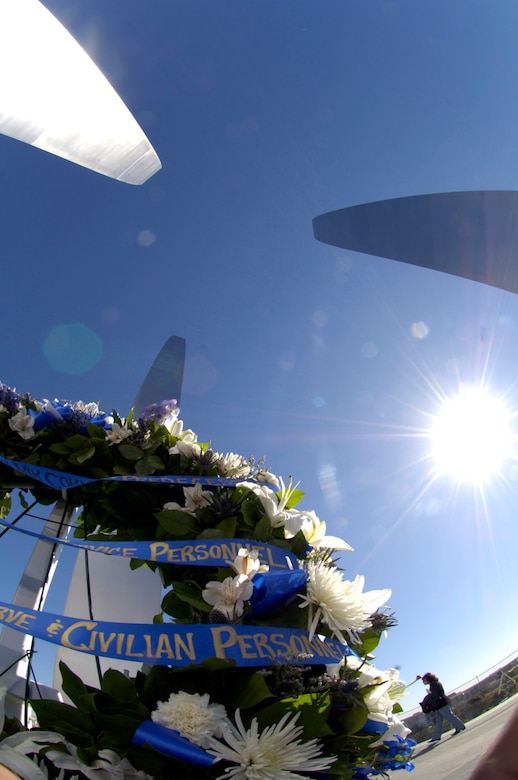 The wreath, placed at the base of the new Air Force Memorial by Secretary of the Air Force Michael W. Wynne, glistens in the sun here in Arlington, Va., Oct. 15. Secretary Wynne was joined by fromer Secretaries of the Air Force, current Chief of Staff T. Michael Moseley and former Chief of staffs and Chief Master Sergeant of the Air Force Rodney McKinley as well as former Chief Master Sergeants of the Air Force in the wreath ceremony.  On behalf of all American citizens President George W. Bush accepted the Air Force Memorial from Air Force Memorial Foundation Chairman Ross Perot Jr. during the previous day's dedication ceremony at the base of the Air Force Memorial that overlooks the Pentagon.  Designed by the late James Ingo Freed the memorial with its three soaring spires inspired by the U.S. Air Force Thunderbirds bomb burst manuever, pays tribute to and honors the patriotic men and women of the U.S. Air Force and its predeccessor organizations. An open house was held near the Pentagon in conjunction with the dedication ceremony which featured performances by the U.S. Air Force Band, the U.S. Air Force Honor Guard drill team, and culminated with a concert featuring country music performer LeeAnn Womack. (U.S. Air Force photo/Tech. Sgt. Cohen Young)