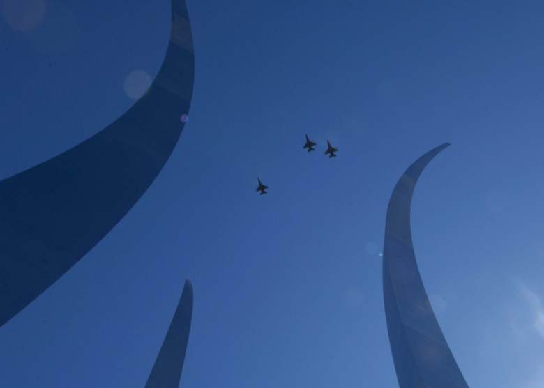 "The Air Force Thunderbirds flew over the new Air Force Memorial in the ""Missing Man"" formation at the conclusion of the wreath dedication ceremony led by Secretary of the Air Force Michael W. Wynne, whom with the help of Air Force Chief of Staff T. Michael Mosely and Air Force Memorial Foudation Chairman Ross Perot, Jr., Chief Master Sergeant of the Air Force Rodney J. McKinley and former Secretaries of the Air Force, Chief of Staffs and Chief Master Sergeants of the Air Force  officially closed the Air Force Memorial commemoration weekend with a wreath laying ceremony in Arlington, Va., Oct. 15, 2006. On behalf of all American citizens President George W. Bush accepted the Air Force Memorial from Air Force Memorial Foundation Chairman Ross Perot Jr. during the previous day's dedication ceremony at the base of the Air Force Memorial that overlooks the Pentagon.  Designed by the late James Ingo Freed the memorial with its three soaring spires inspired by the U.S. Air Force Thunderbirds bomb burst manuever, pays tribute to and honors the patriotic men and women of the U.S. Air Force and its predeccessor organizations. An open house was held near the Pentagon in conjunction with the dedication ceremony which featured performances by the U.S. Air Force Band, the U.S. Air Force Honor Guard drill team, and culminated with a concert featuring country music performer LeeAnn Womack. (U.S. Air Force photo/Tech. Sgt. Cohen Young)"