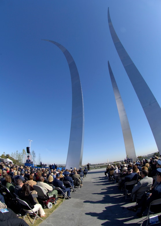 Hundreds gathered at the base of the new Air Force Memorial  as Secretary of the Air Force Michael W. Wynne officially closed the Air Force Memorial commemoration with a wreath laying ceremony in Arlington, Va., Oct. 15, 2006. Looking on are, from left: Chief Master Sgt. of the Air Force Rodney J. McKinley, Air Force Memorial Foundation Chairman Ross Perot Jr. , and Air Force Chief of Staff Gen. T. Michael Moseley.  On behalf of all American citizens President George W. Bush accepted the Air Force Memorial from Air Force Memorial Foundation Chairman Ross Perot Jr. during the previous day's dedication ceremony at the base of the Air Force Memorial that overlooks the Pentagon.  Designed by the late James Ingo Freed the memorial with its three soaring spires inspired by the U.S. Air Force Thunderbirds bomb burst manuever, pays tribute to and honors the patriotic men and women of the U.S. Air Force and its predeccessor organizations. An open house was held near the Pentagon in conjunction with the dedication ceremony which featured performances by the U.S. Air Force Band, the U.S. Air Force Honor Guard drill team, and culminated with a concert featuring country music performer LeeAnn Womack. (U.S. Air Force photo/Tech. Sgt. Cohen Young)