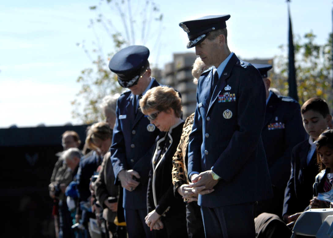 Heads are bowed and hands are crossed during the opening prayer of the Wreath Ceremony held at the base of the new Air Force Memorial in Arlington, Va., Oct. 15, 2006. Secretary of the Air Force Michael W. Wynne officially closed the Air Force Memorial commemoration by leading the wreath laying ceremony.  (U.S. Air Force photo/Tech. Sgt. Cohen Young)