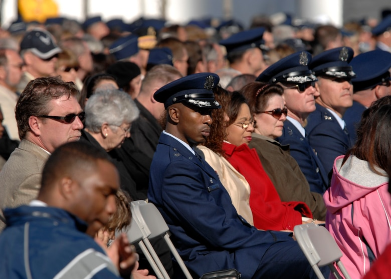 Hundreds gathered at the base of the new Air Force Memorial as Secretary of the Air Force Michael W. Wynne officially closed the Air Force Memorial commemoration with a wreath laying ceremony in Arlington, Va., Oct. 15, 2006. On behalf of all American citizens President George W. Bush accepted the Air Force Memorial from Air Force Memorial Foundation Chairman Ross Perot Jr. during the previous day's dedication ceremony at the base of the Air Force Memorial that overlooks the Pentagon.  Designed by the late James Ingo Freed the memorial with its three soaring spires inspired by the U.S. Air Force Thunderbirds bomb burst manuever, pays tribute to and honors the patriotic men and women of the U.S. Air Force and its predeccessor organizations. An open house was held near the Pentagon in conjunction with the dedication ceremony which featured performances by the U.S. Air Force Band, the U.S. Air Force Honor Guard drill team, and culminated with a concert featuring country music performer LeeAnn Womack. (U.S. Air Force photo/Tech. Sgt. Cohen Young)