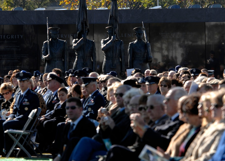 Hundreds sat around and neat the Honor Guard statue at the base of the new Air Force Memorial while Secretary of the Air Force Michael W. Wynne officially closed the Air Force Memorial commemoration with a wreath laying ceremony in Arlington, Va., Oct. 15, 2006. On behalf of all American citizens President George W. Bush accepted the Air Force Memorial from Air Force Memorial Foundation Chairman Ross Perot Jr. during the previous day's dedication ceremony at the base of the Air Force Memorial that overlooks the Pentagon.  Designed by the late James Ingo Freed the memorial with its three soaring spires inspired by the U.S. Air Force Thunderbirds bomb burst manuever, pays tribute to and honors the patriotic men and women of the U.S. Air Force and its predeccessor organizations. An open house was held near the Pentagon in conjunction with the dedication ceremony which featured performances by the U.S. Air Force Band, the U.S. Air Force Honor Guard drill team, and culminated with a concert featuring country music performer LeeAnn Womack. (U.S. Air Force photo/Tech. Sgt. Cohen Young)