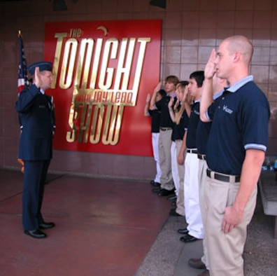 Seven Southern California residents joined the Air Force Reserve on Tuesday before the taping of The Tonight Show with Jay Leno during the command's yearly accessions' week program.  Each October, Air Force Reserve Command recruiting asks its wings to perform a mass enlistment ceremony at some unique location.  This year, the newest recruits were enlisted at NBC in Burbank, Calif.  The Tonight Show guests featured professional golfer Tiger Woods, Chef Emeril Lagasse and rapper Chingy. (U.S. Air Force photo by Maj Don Traud, 452 AMW/PA)