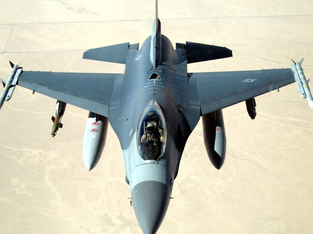 """Lt. Col. Gary Middlebrooks gives a """"thumbs up"""" after successfully refueling his F-16 Fighting Falcon from a KC-10 Extender Oct. 17 in Southwest Asia. Aircraft from the 908th Expeditionary Air Refueling Squadron, assigned to the 380th Air Expeditionary Wing including the KC-10 and KC-135 Stratotanker, provide fuel for coalition aircraft missions for Operations Iraqi Freedom and Enduring Freedom. Colonel Middlebrooks from the 332nd Expeditionary Fighter Squadron at Balad Air Base, Iraq, and is deployed from the 114th Fighter Wing of the South Dakota Air National Guard. (U.S. Air Force photo)"""