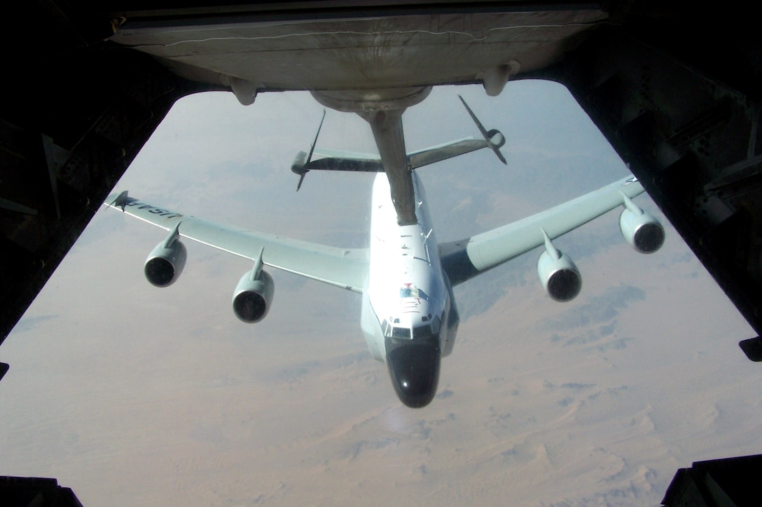 An RC-135 Rivet Joint aircraft pulls up to the boom of a KC-10 Extender during an air refueling mission Oct. 17 over Southwest Asia. Aircraft from the 908th Expeditionary Air Refueling Squadron, including the KC-10 and KC-135 Stratotanker, provide fuel for coalition aircraft missions for Operations Iraqi Freedom and Enduring Freedom. The squadron is attached to the 380th Air Expeditionary Wing, the largest air refueling wing in Southwest Asia. (U.S. Air Force photo/Senior Airman Matt Craig)