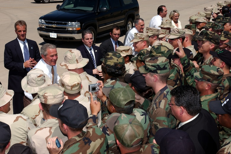 President George W. Bush greets troops from the 56th Fighter Wing at Luke Air Force Base, Ariz., August 29, 2005. The President arrived at Luke before going to an El Mirage town hall meeting to rally support for his new Medicare plan. (Photo by Senior Airman Joseph Thompson)